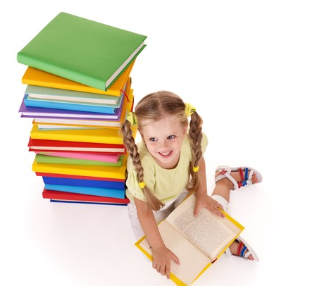 able to learn: Little girl reading pile of books. Isolated.