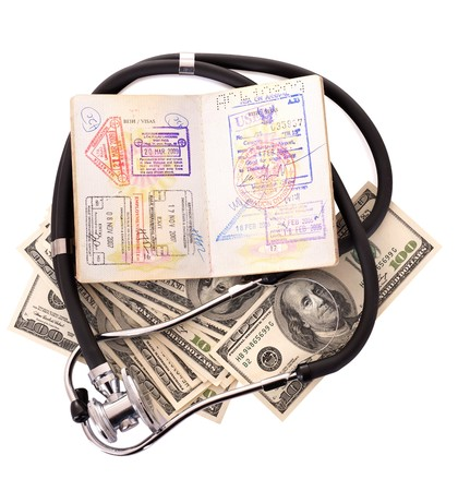 Medical still life with stethoscope, money and passport. Isolated. Stock Photo - 7779864