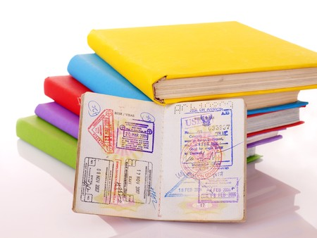 Still life with books  and passport. Isolated. photo
