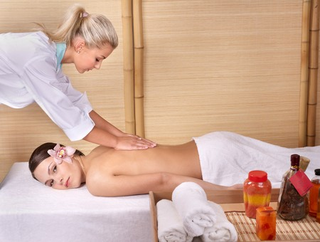 Young beautiful woman on massage table in beauty spa. Series. Stock Photo - 7779877
