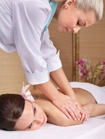 Young beautiful woman on massage table in beauty spa. Series. Stock Photo - 7779872