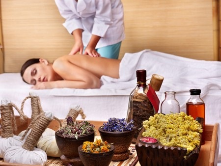 Young beautiful woman on massage table in beauty spa. Series. Stock Photo - 7779831