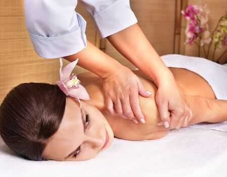 Young beautiful woman on massage table in beauty spa. Series. Stock Photo - 7779969