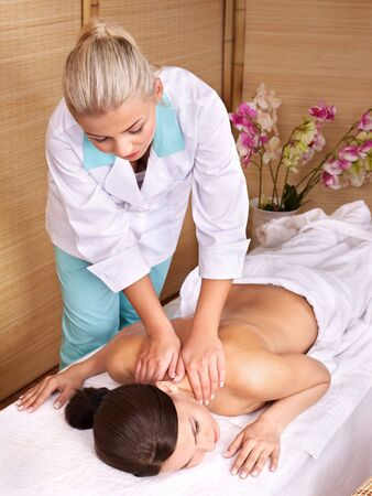 Young beautiful woman on massage table in beauty spa.  Series. Stock Photo - 7779975