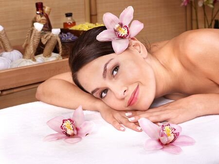 Young beautiful woman on massage table in beauty spa. Series. Stock Photo - 7779960