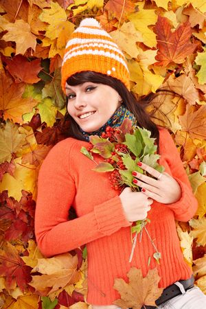 Young woman in autumn orange leaves. Outdoor. Stock Photo - 7779917