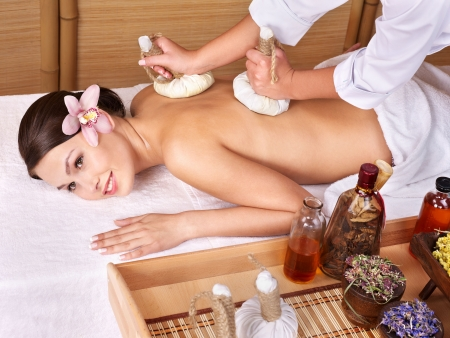 day spa: Young beautiful woman on massage table in beauty spa. Series.