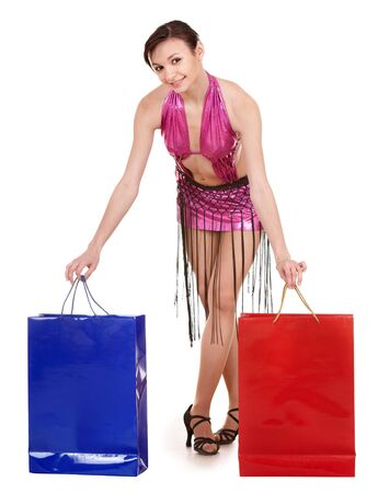 Young woman with shopping bag. Dance shop. photo