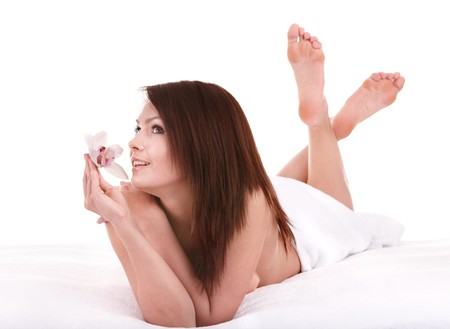 young girl feet: Young beautiful woman on massage table in beauty spa.