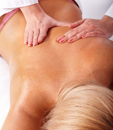Massage of female back. Health and beauty.