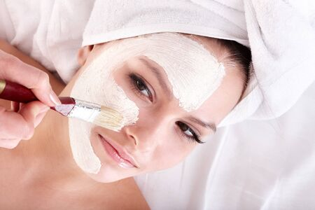 Young woman with clay facial mask. Stock Photo - 7890013