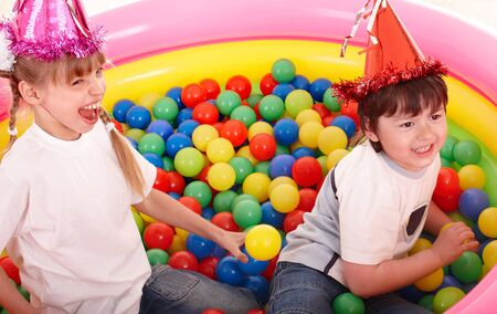 balls kids: Happy children in colored ball. Stock Photo
