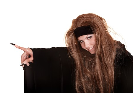 Witch in black costume and long hair point claw finger.Isolated. Stock Photo - 7890015
