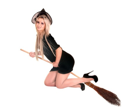 Young woman witch fly on  broom. Isolated. photo