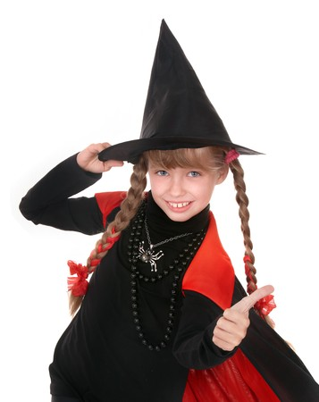 Child girl witch in black costume  with thumb. Isolated. photo