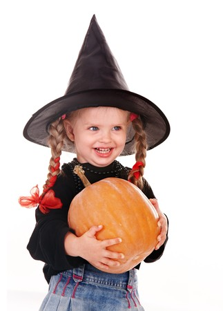 Child girl  Halloween witch  in black hat and dress with pumpkin, broom.Isolated. Stock Photo - 7888645