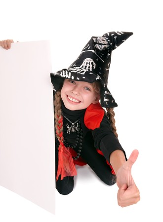Child  witch holding banner and thumb up. Isolated. photo