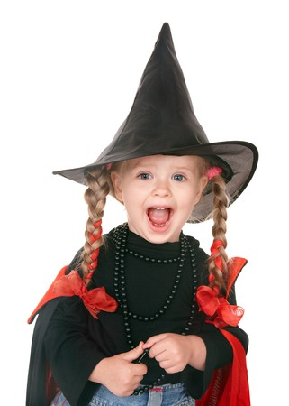 Little girl witch in black hat. Isolated. photo