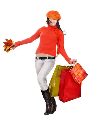 Young woman in  orange holding shopping bag. Isolated. Stock Photo - 7887887