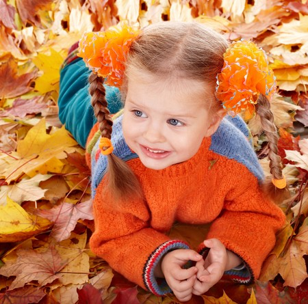 Girl child in autumn orange leaves. Outdoor. Stock Photo - 7889973