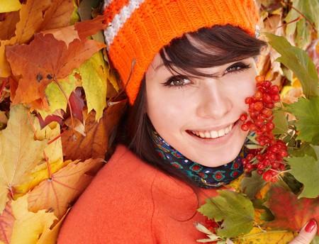 Girl in autumn orange leaves.  Outdoor. photo