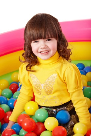 Happy child in group colourful ball. Isolated. Stock Photo - 7890038