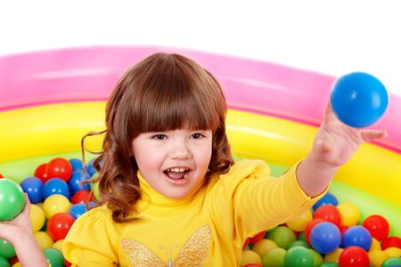 playcentre: Happy little girl play in group colourful ball.