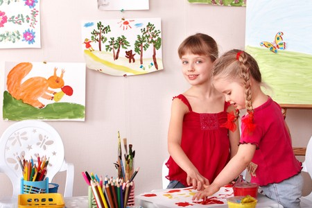 kids drawing: Children painting colour paints in preschool. Stock Photo