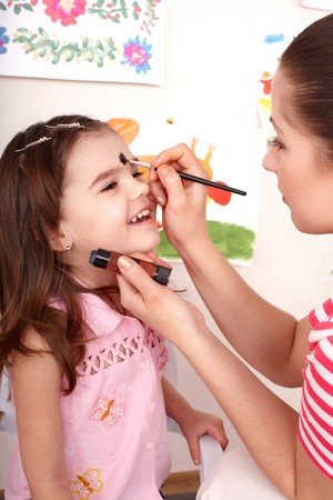 Child preschooler with face painting. Child care. photo