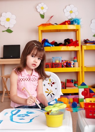 Child with paint  in art class . Preschool. Stock Photo - 7889835