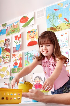 Child with paint  in art class . Preschool. Stock Photo - 7889129