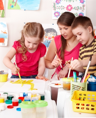 children painting: Children painting with teacher. Child development.