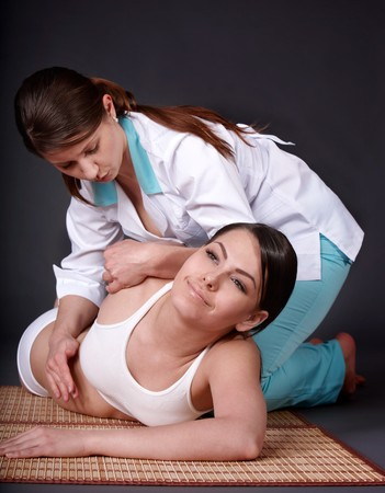 Young woman l having thai massage. photo