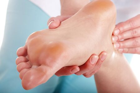acupressure hands: Young woman having foot massage.