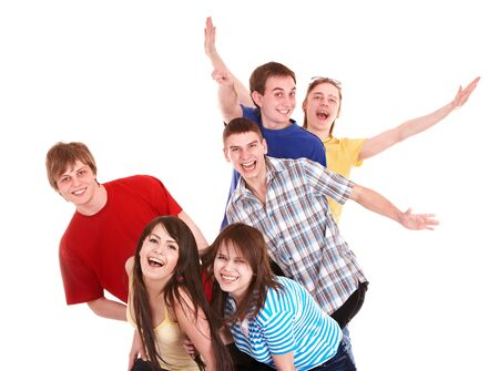Group of happy young people with hand up. Isolated. photo