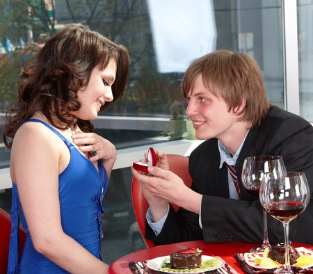 Man propose marriage to girl. Loving couple. photo