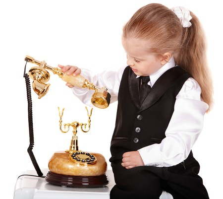 Little girl in business suit call telephone. Isolated. Stock Photo - 7889285