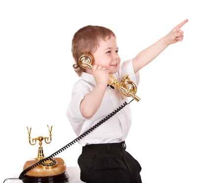 Little boy talk on telephone. Isolated. Stock Photo - 7888530