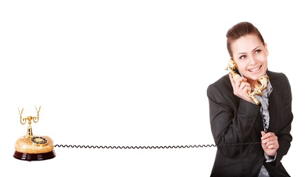 Happy businesswoman with golden phone. Isolated. Stock Photo - 7888229