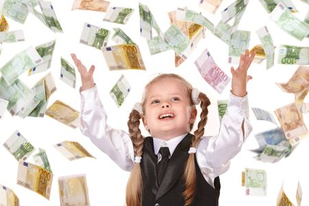 Little girl in business suit with flying money. Isolated. photo