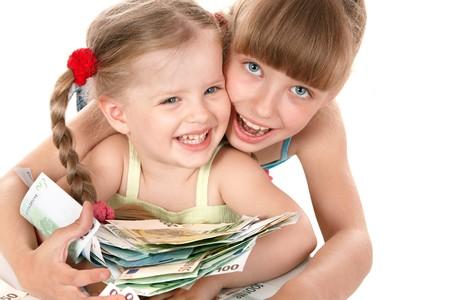 stack of money: Children holding pile of money. Isolated.