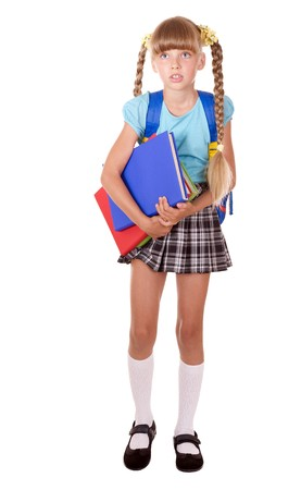 School girl with backpack holding books. Isolated. photo