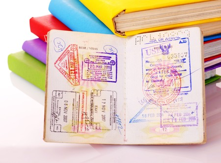 Pile of book with passport. Foreign education. photo