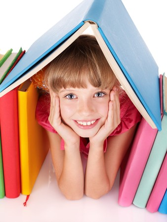 Little girl reading open  book on table. Isolated. Stock Photo - 7890130