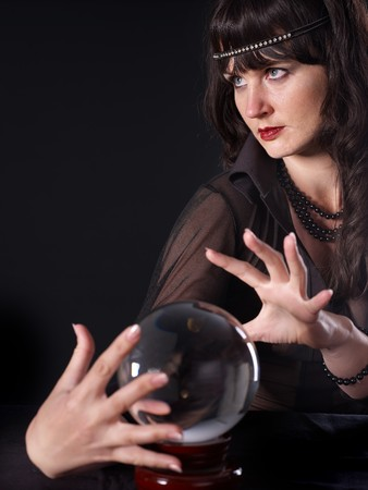 Young woman  with crystal ball. Beauty and fashion. Stock Photo - 7890162