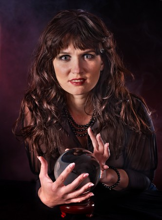 Young woman  with crystal ball. Beauty and fashion. Stock Photo - 7890142