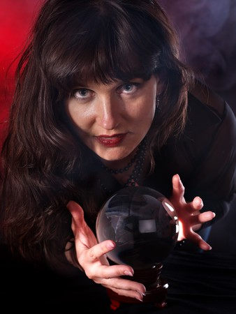 Young woman  with crystal ball. Beauty and fashion. Stock Photo - 7890114