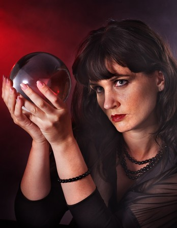 Young woman  with crystal ball. Beauty and fashion. Stock Photo - 7890154
