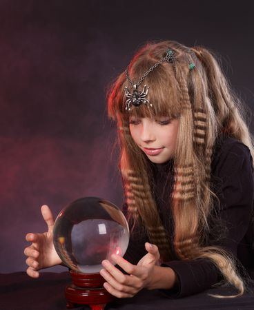Little girl holding crystal ball.Series. photo