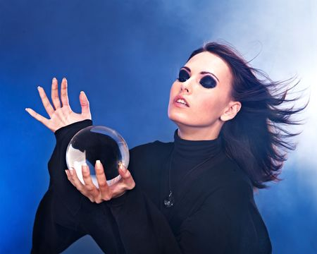 Young beautiful woman with crystal ball. Stock Photo - 7890175